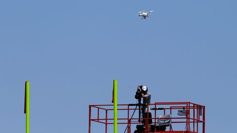A drone hovers over the practice field during a Dallas Cowboys organized team activity at the NFL football team's headquarters on June 10, 2015, in Irving, Texas.