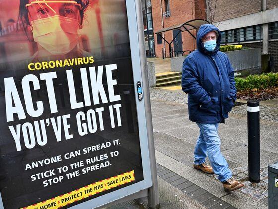 Pfizer Curbs Severe Covid; U.K. to End Mask Rules: Virus Update