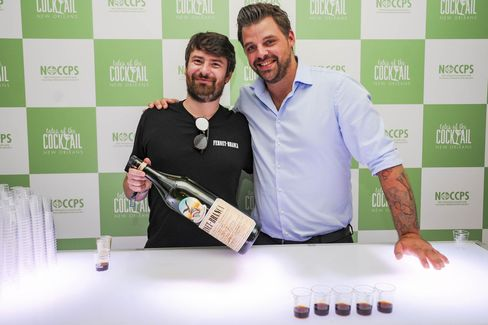 Edoardo Branca (left) toasts Fernet Branca at the Tales of the Cocktail trade show in 2016.