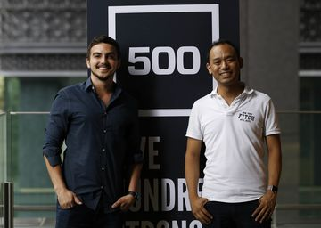 James Riney, head of 500 Startups Japan, (L) andYohei Sawayama, managing partner of 500 Startups Japan, pose for a photograph next to its company logo following an interview in Tokyo, Japan, on Tuesday, August 23, 2016. Photographer: Yuya Shino/Bloomberg