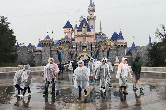Disney Fans Descend on Theme Parks Before Virus Shuts Them Down