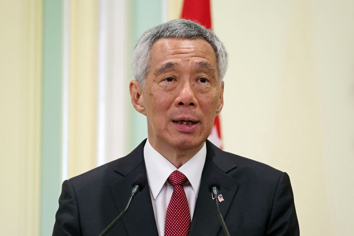 Singapore Leader's Wife Defends His Seven-Figure Pay on Facebook