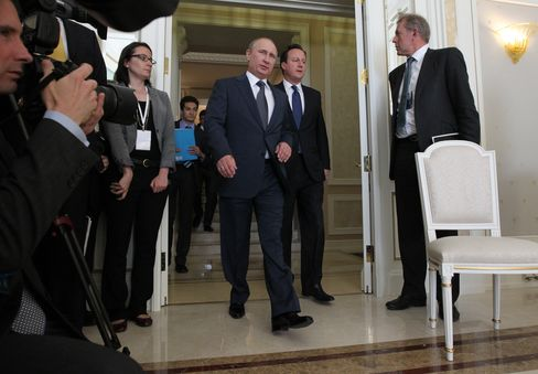 Putin Joins Cameron in Planning Steps Toward Syria Peace Deal