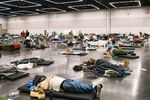 People rest at the Oregon Convention Center cooling station in Portland on June 28, 2021, after swathes of the U.S.and Canada endured record-setting heat that lead to deaths of hundreds of people.