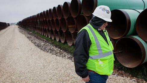 A worker walks through the TransCanada Corp. Houston Lateral Project pipe yard in Mont Belvieu, Texas, U.S., on Wednesday, March 5, 2014. Russ Girling, TransCanada Corp. president and chief executive officer, said he remains