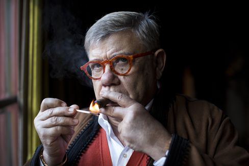 Jean-Yves Ollivier lights a cigar at his residence in Marrakesh, Morocco, on Monday, Dec. 1, 2014.