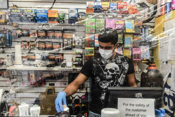 Sneeze Guards and Temperature Checks Are the New Normal for U.S. Retail
