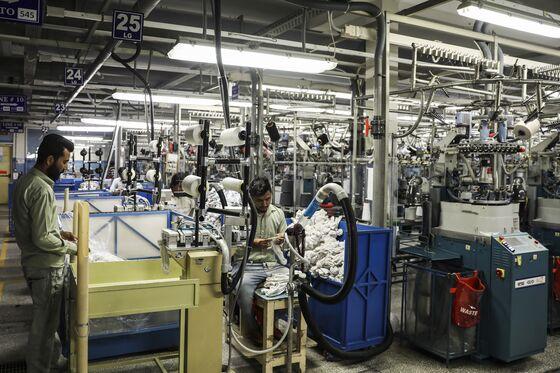 Pakistan Reopens Factories During Virus Lockdown as Exports Drop