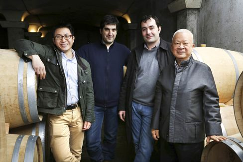 From left: Howard Kwok, winemaker Jerome Aguirre, Vignobles K general manager Jean-Christophe Meyrou, and Peter Kwok pose in the new barrel cellar at Chateau Tour Saint Christophe.