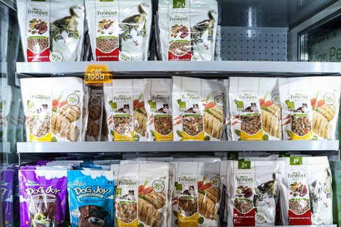 Freshpet dog meals in a refrigerated display case.